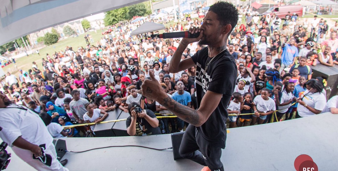 Photo Header: Artist performing at June's Kickback Festival