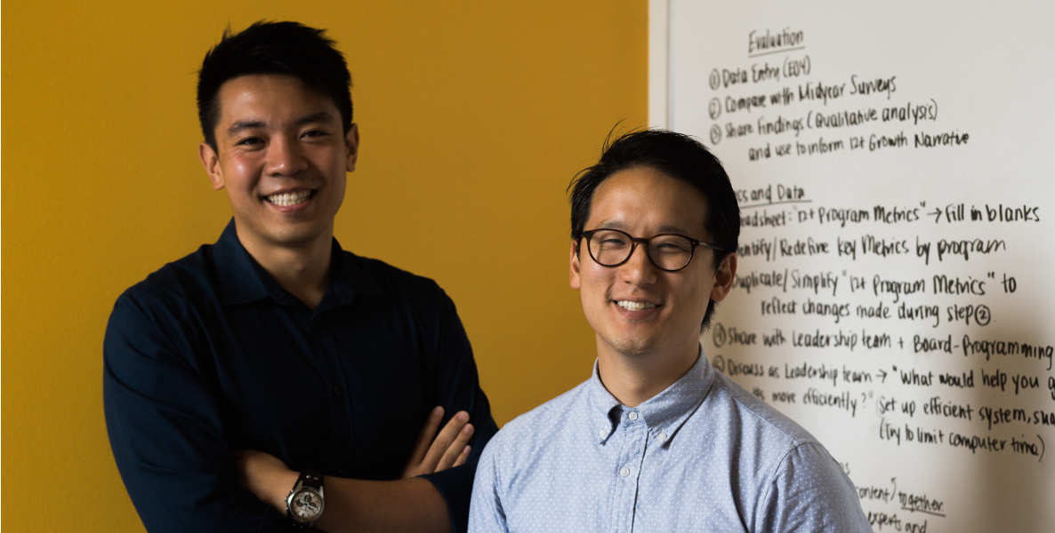The two people are Raymond John and Frank Wang. Raymond is the CEO and Frank is a Staff Teacher. Raymond is on the left and Frank the right.