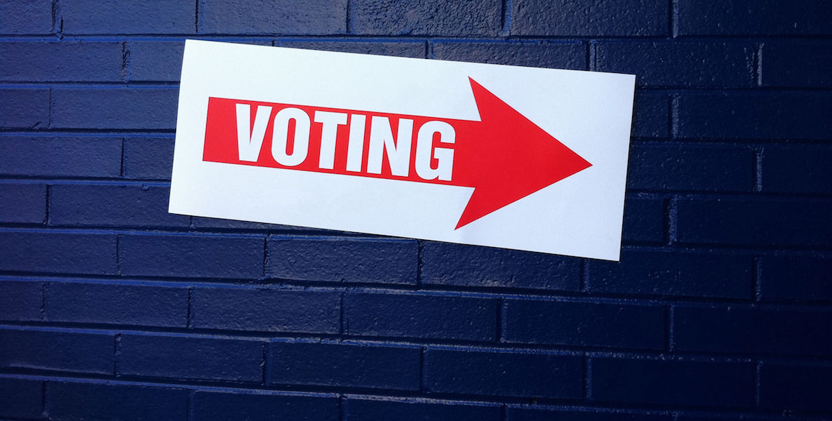 A sign points voters to early voting satellite stations, which make it easer to vote early in the state of Pennsylvania