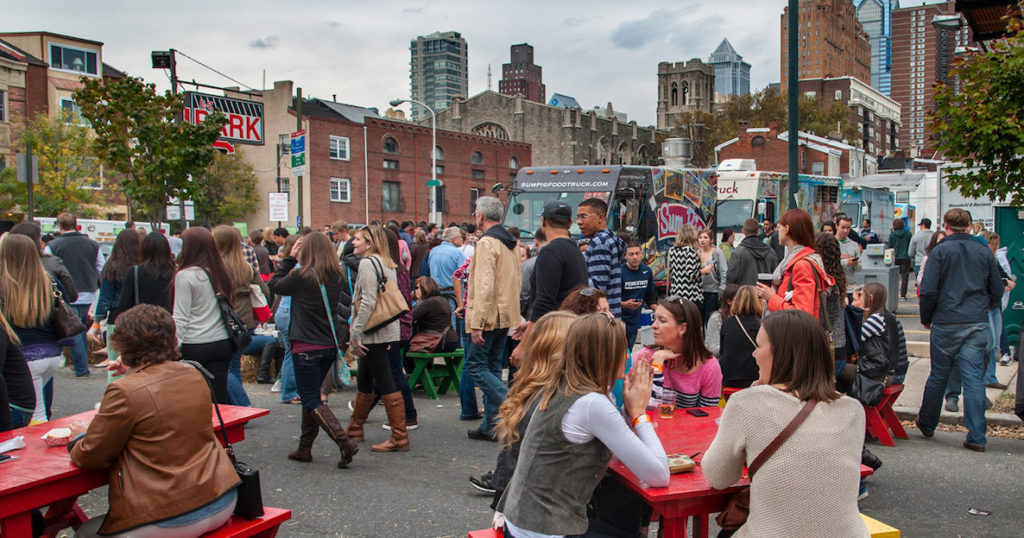 A crowd gathers in the street for Bloktoberfest in South Philadelphia