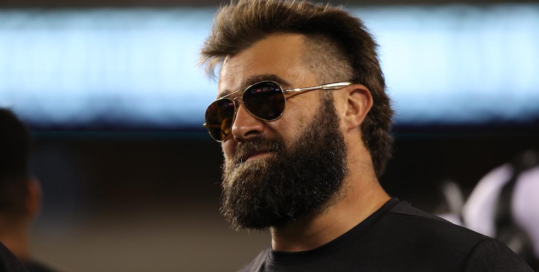 Philadelphia Eagles offensive lineman Jason Kelce wears a pair of sunglasses, looking too cool school for school.