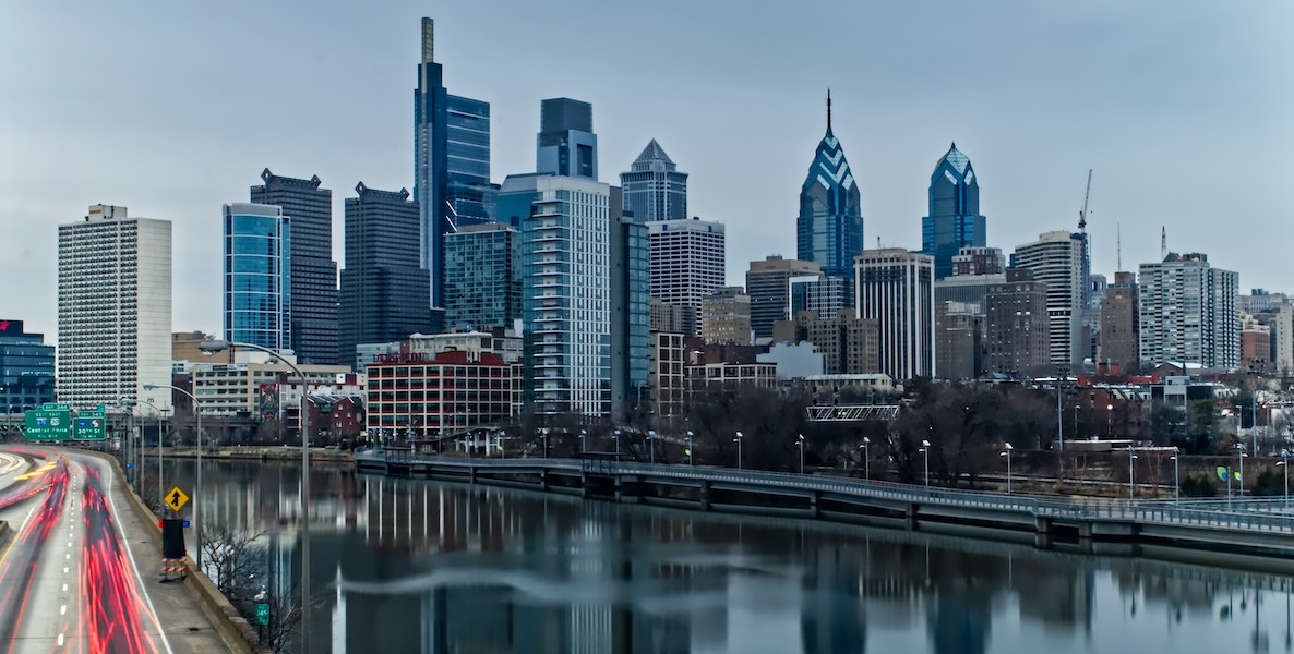 The Philadelphia skyline juts up over the river