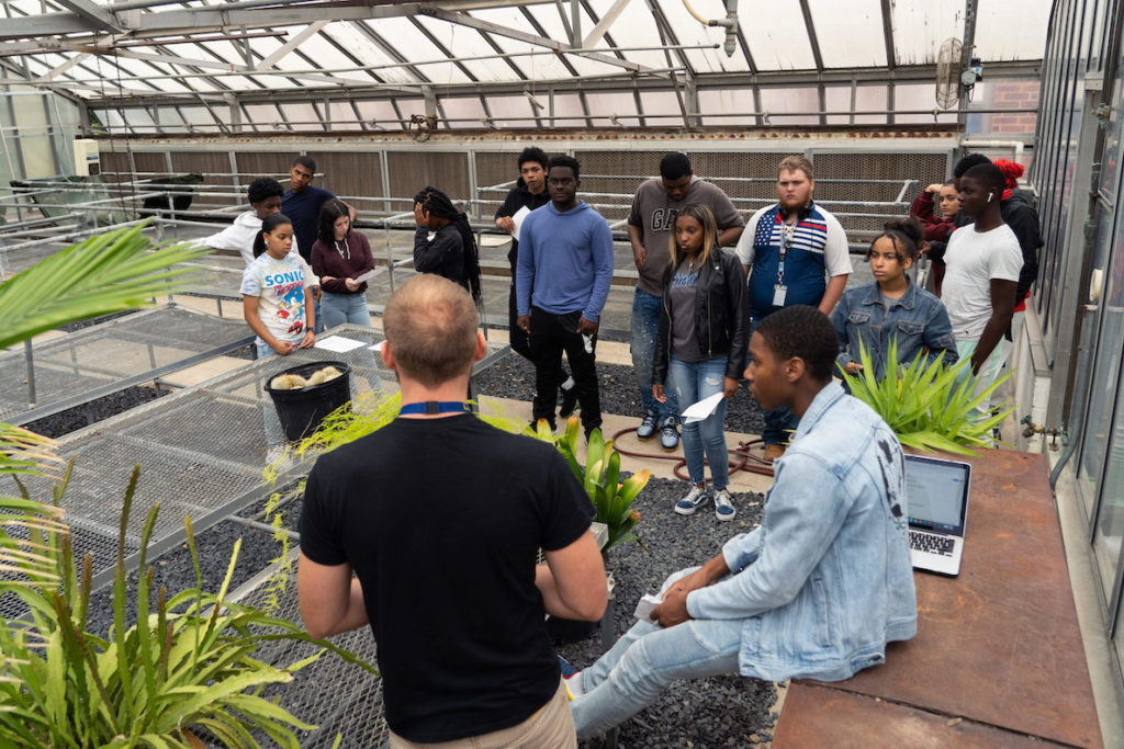 Kids take lessons in a greenhouse at an agricultural high school in the Roxborough section of Philadelphia