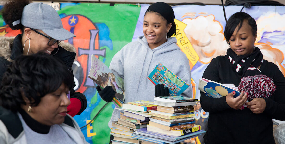 Teens hand out books at a Martin Luther King Day of service event in Philadelphia.