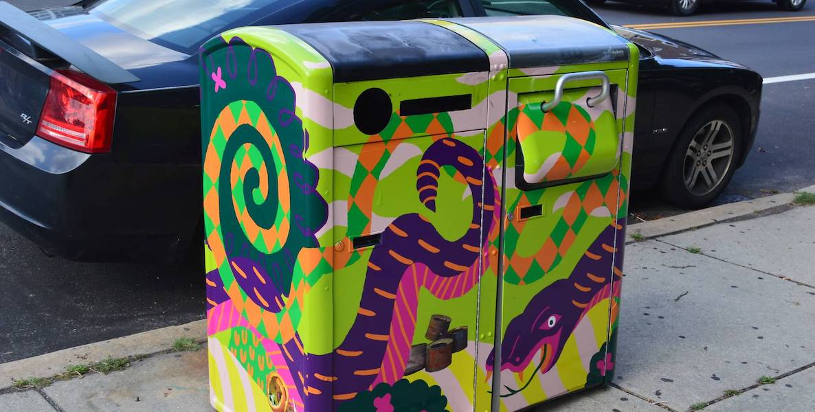 Two Big Belly garbage cans in Philadelphia are decorated with designs by a local artist.