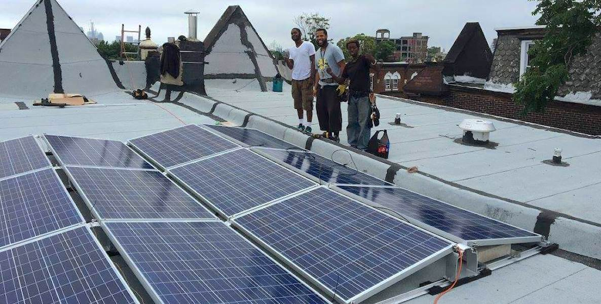 Members of Serenity Soular install solar panels on a home in Philadelphia