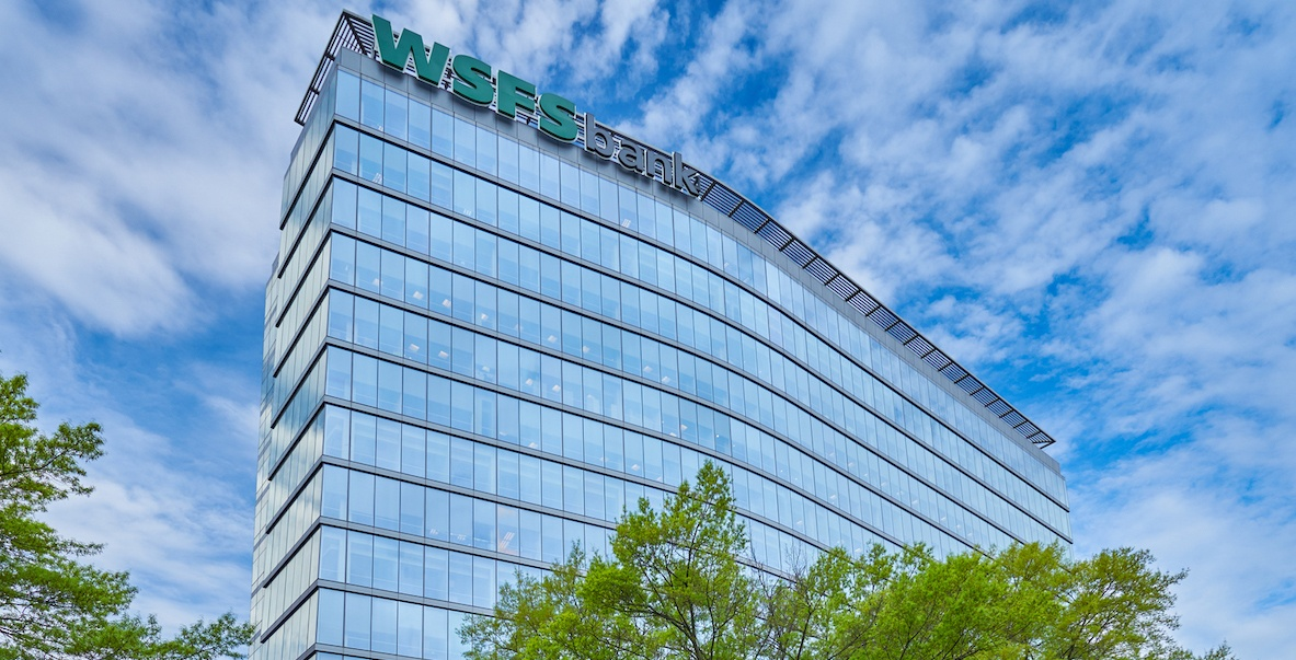 WSFS bank with a sunny, cloud-filled sky as a backdrop.