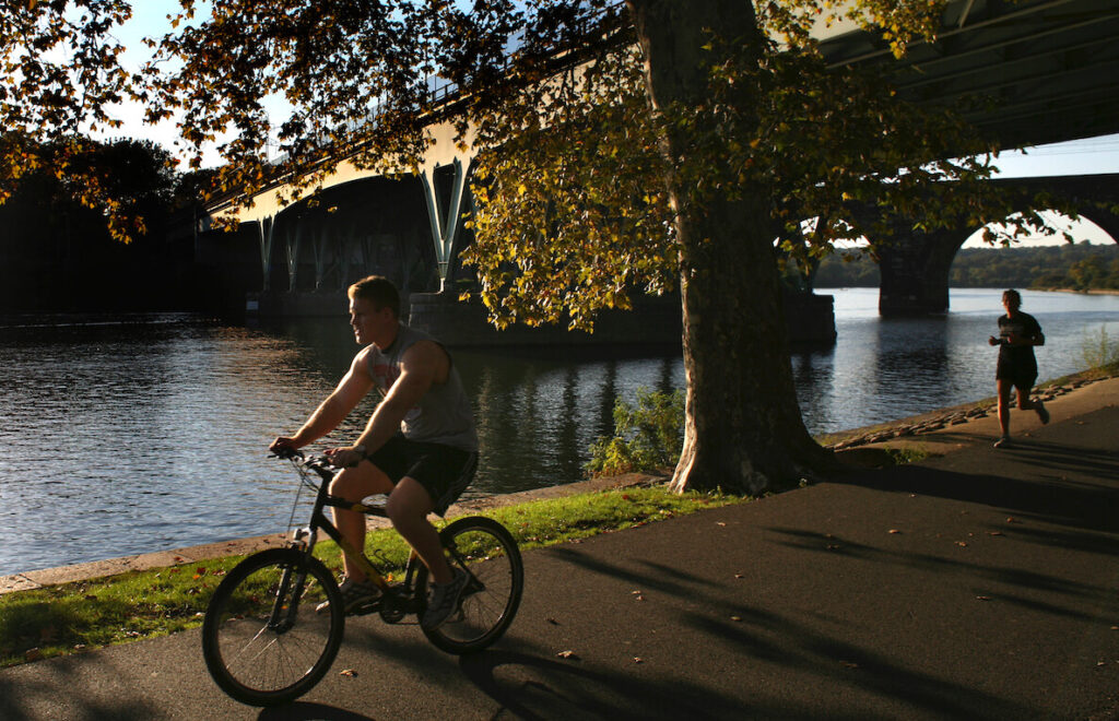 A man rides his bike along the Schuylkill Trail near Center City Philadelphia.