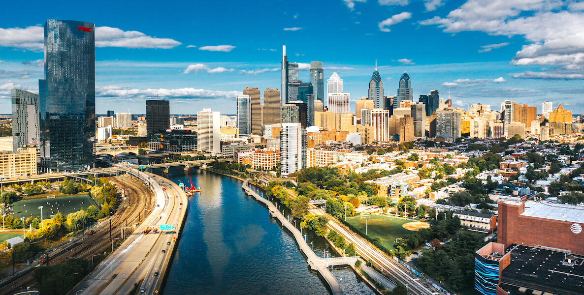 Philadelphia skyline in 2020 shows both Comcast buildings and the Schuylkill River