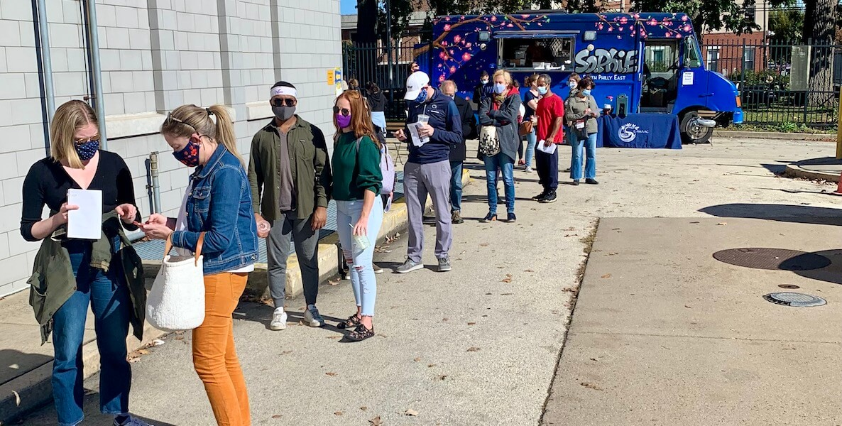 Voters in Philadelphia line up outside a satellite election office in South Philly