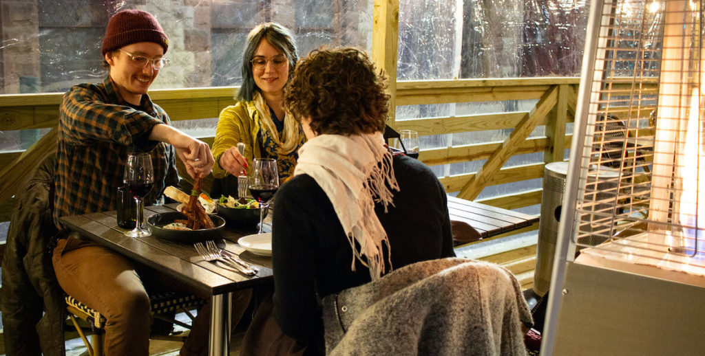 Diners enjoy dinner at the outdoor seating area at Abe Fisher in Philadelphia