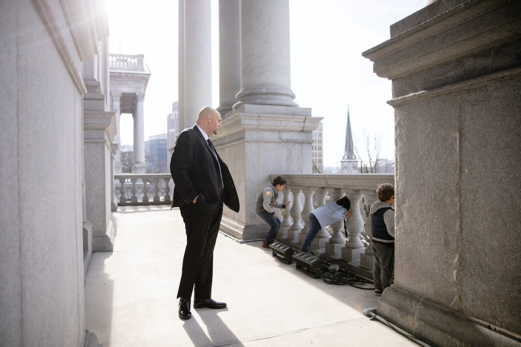 Pennsylvania Lieutenant Governor John Fetterman looks over his sons playing on the capitol steps