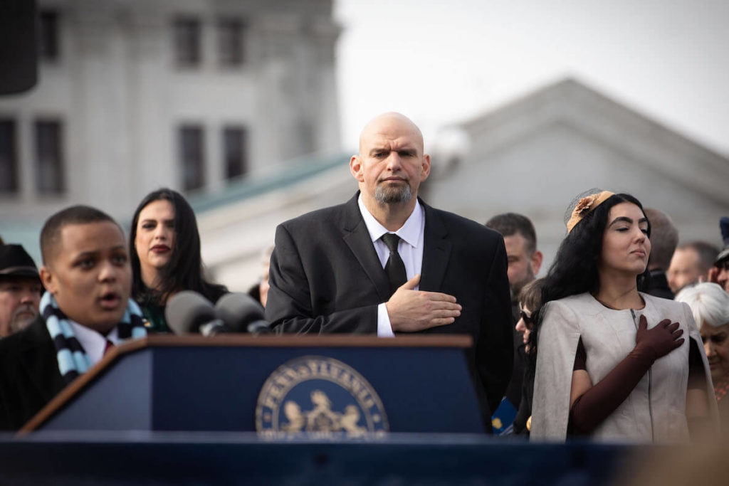 Pennsylvania Lieutenant Governor John Fetterman has his hand on his heart during the National Anthem
