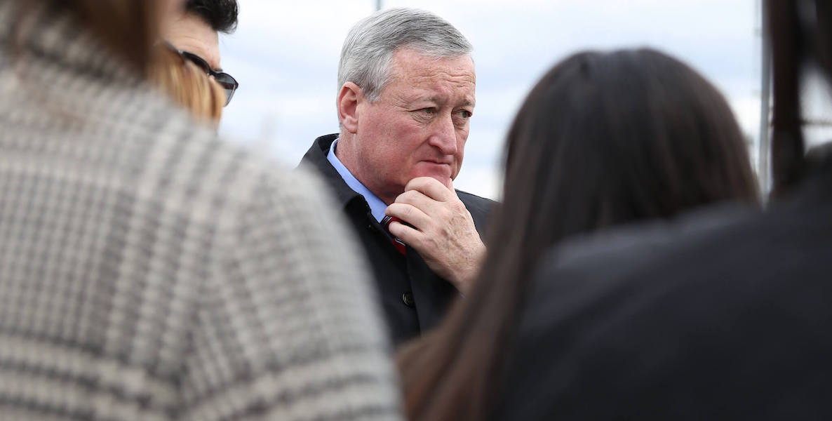 Philadelphia Mayor Jim Kenney looking pensive in a crowd of people