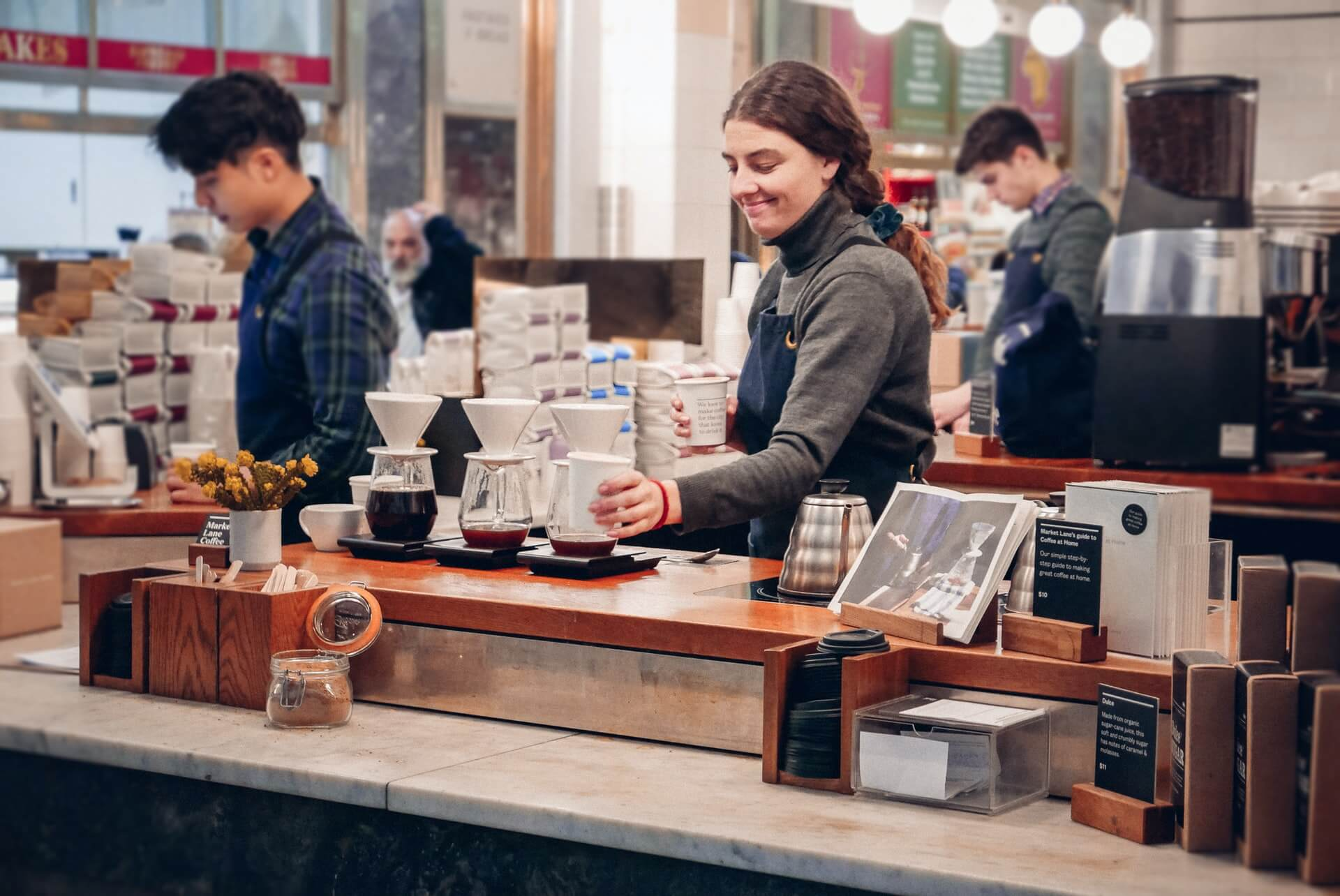 Young woman serving coffee at a cafe