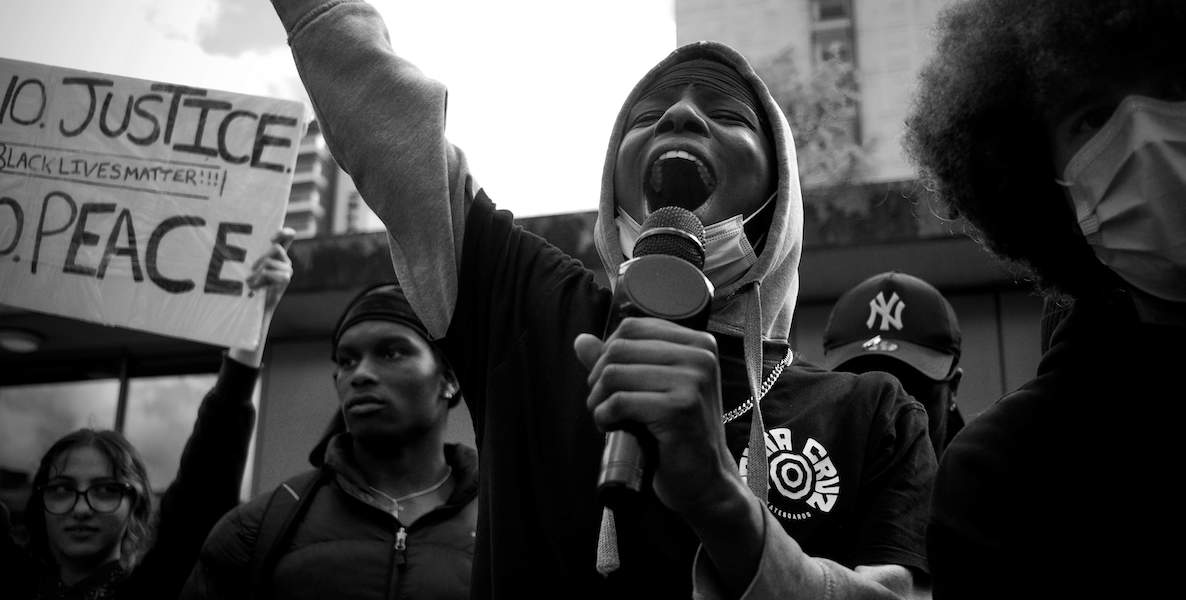 A woman speaks at a protest against police brutality in the wake of George Floyd's murder