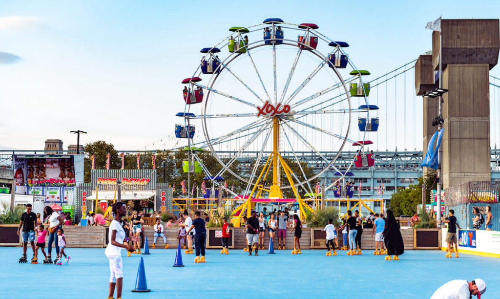 The ferris wheel and other attractions at Blue Cross RiverRink Summerfest