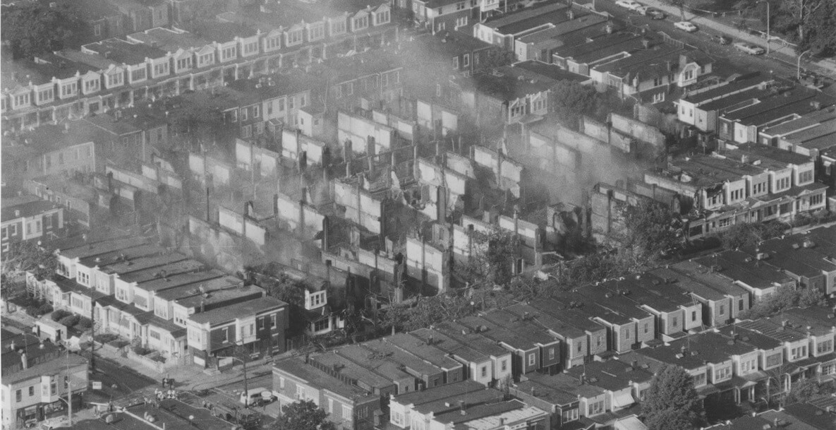 black and white photo showing destruction caused by MOVE bombing in 1985