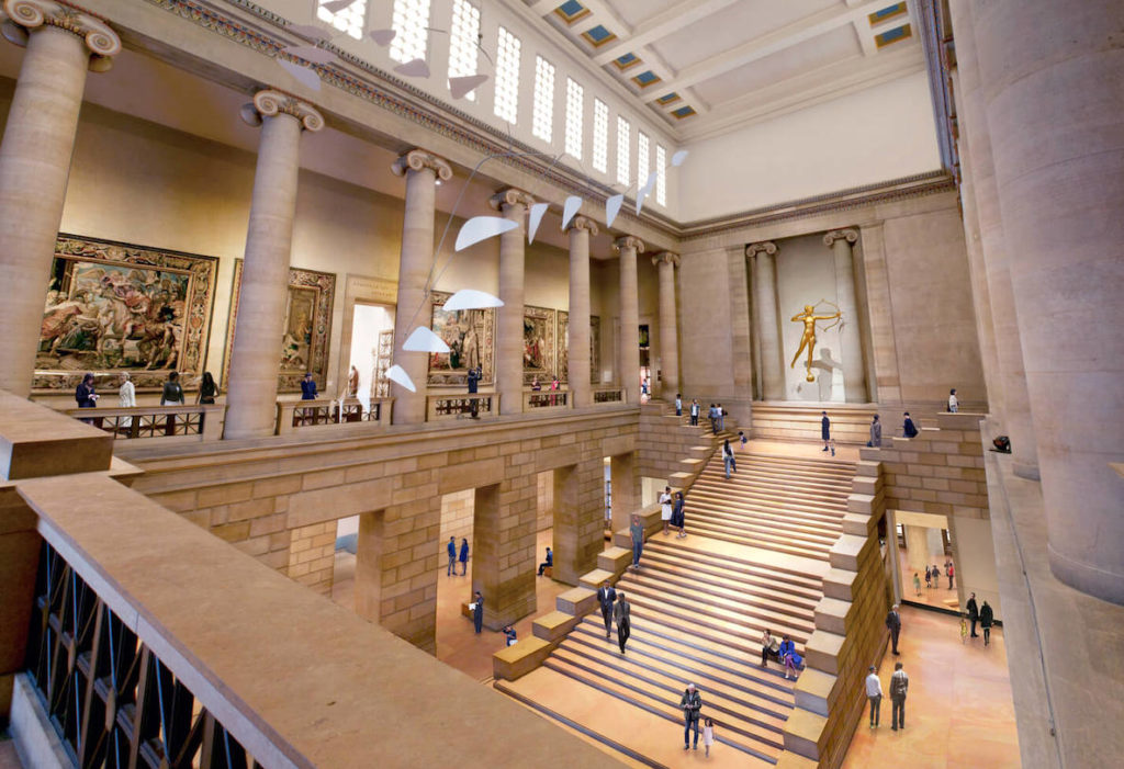 Guests mill about the Great Stair Hall in the Philadelphia Museum of Art