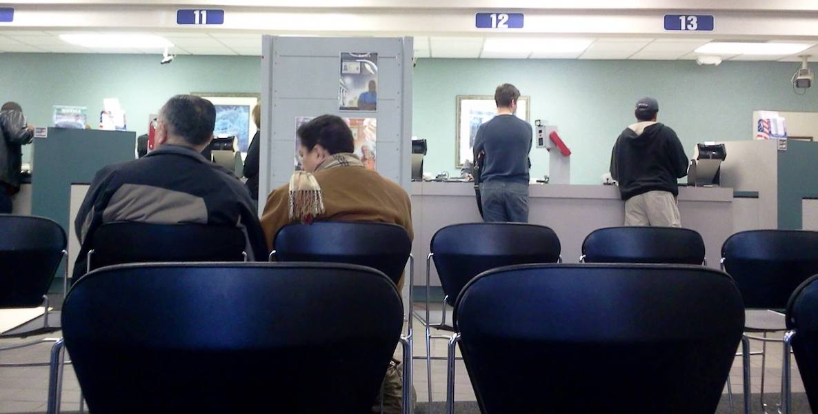 A photo of people waiting in line at the DMV office accompanies an article about how easy it is to get a Real ID in the state of Pennsylvania