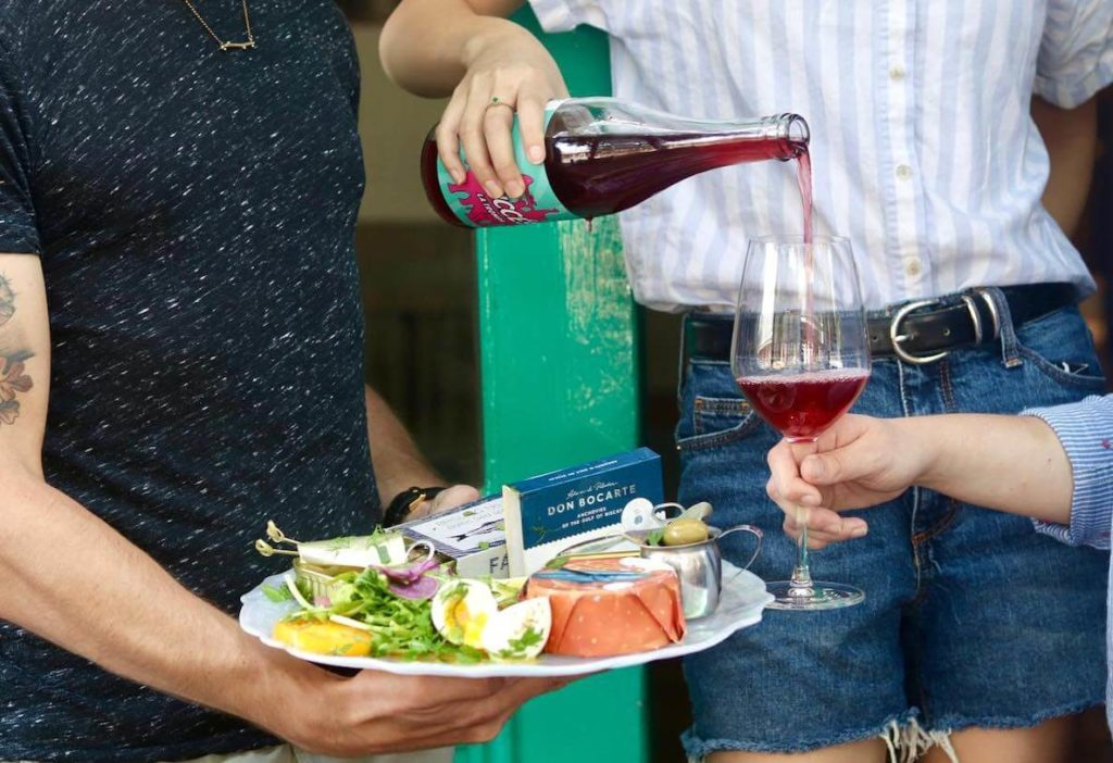 This photo of a plate of food and wine at Bloomsday accompanies an article about the best and most beautiful places to eat outdoors in Philadelphia