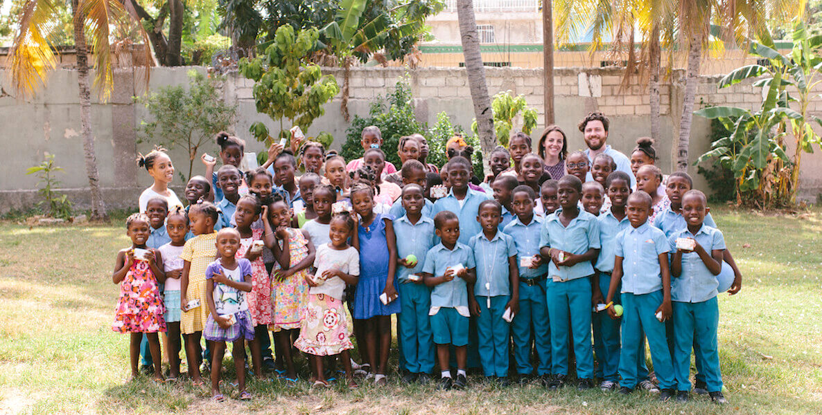 Hand in Hand founders with beneficiaries in Haiti