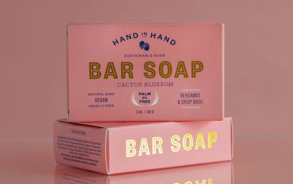 A stack of Hand in Hand soaps in pretty pink boxes