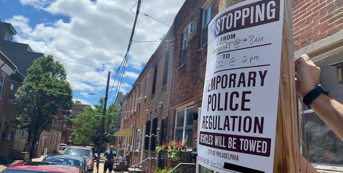 A No Stopping sign hangs on a light pole in South Philadelphia as part of the street closure permit process