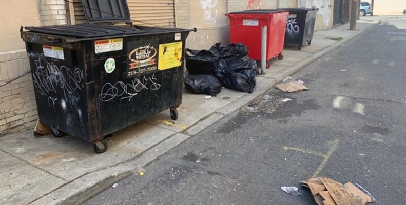dumpsters and piles of trash on South Watts Philadelphia